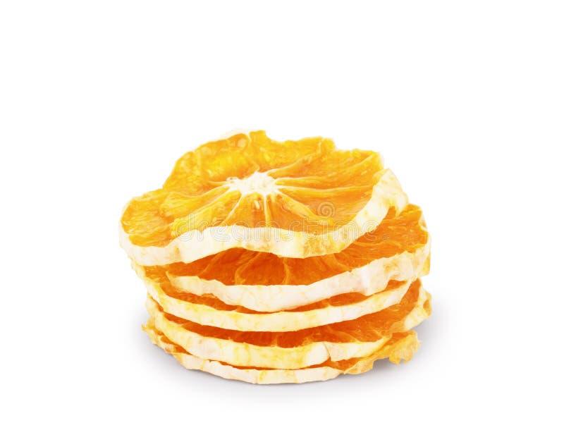 Morceaux oranges secs sur un fond blanc photo stock