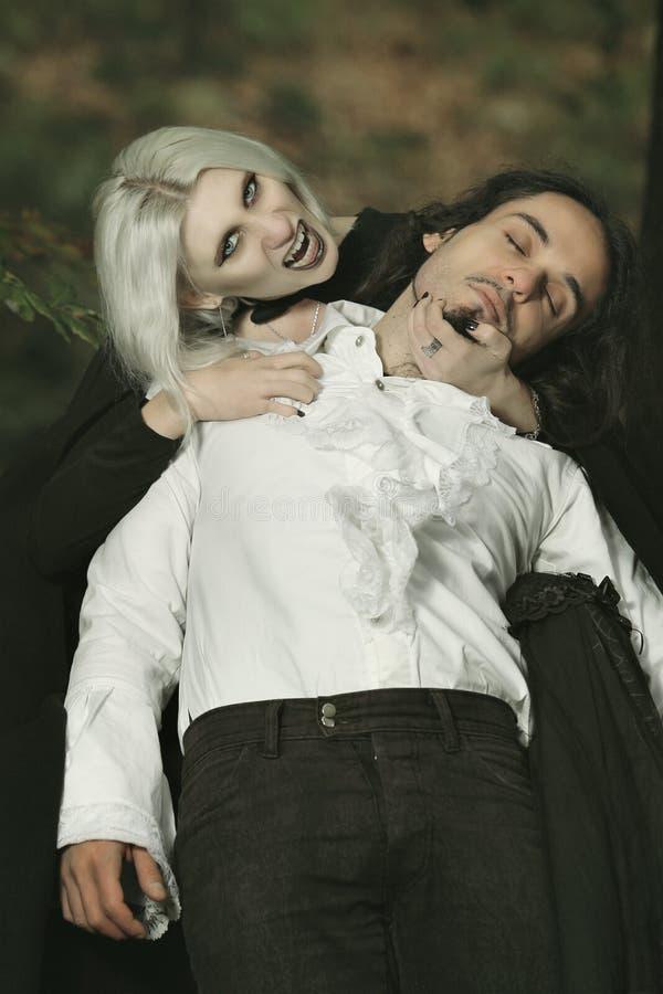 Mordida do vampiro imagem de stock