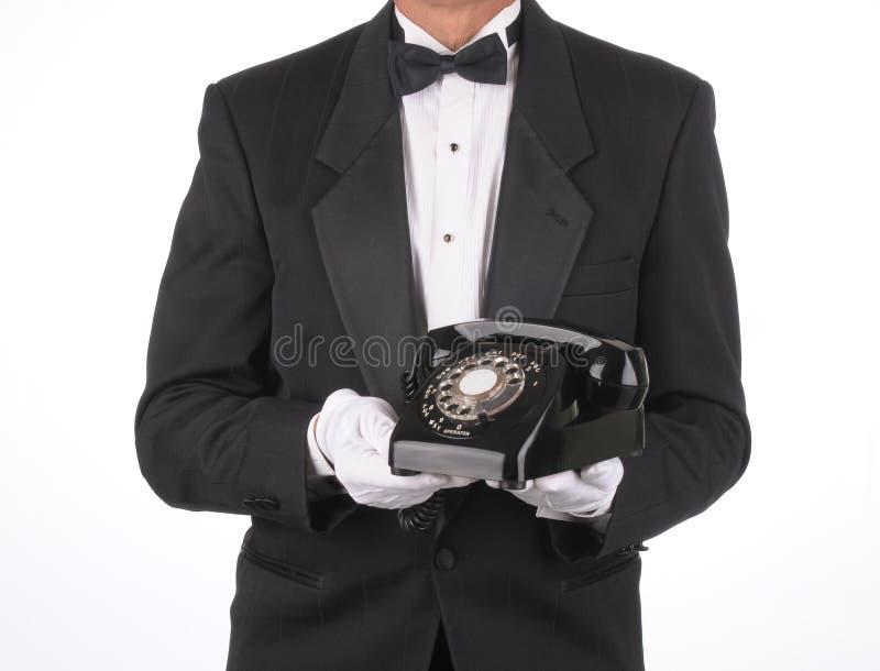 Mordomo com telefone foto de stock