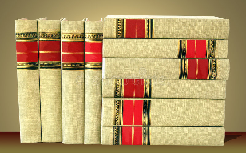 More Books. Stack of cloth-bound books on a warm background royalty free stock image