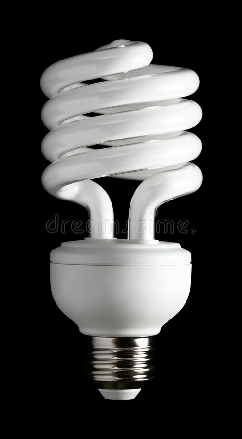 A more efficient bulb. Fluorescent light bulb isolated on a black background stock images