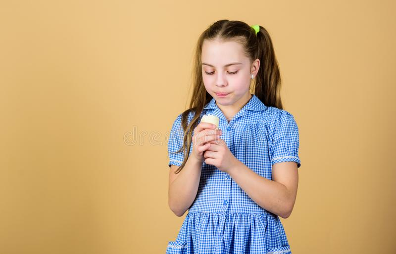 More flavor more fun. Small child licking ice cream with natural flavor. Cute little girl enjoy flavor and aroma of. Frozen dessert. Adorable kid eating flavor stock photos