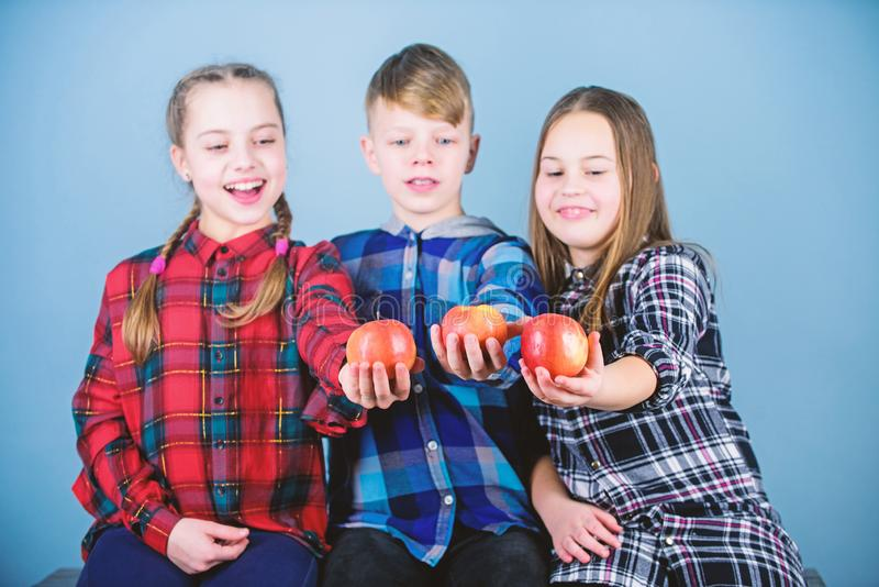 More organic goodness. Little children holding red organic apples. Small children enjoy eating natural organic fruits. Providing organic lunches and snacks for royalty free stock photo