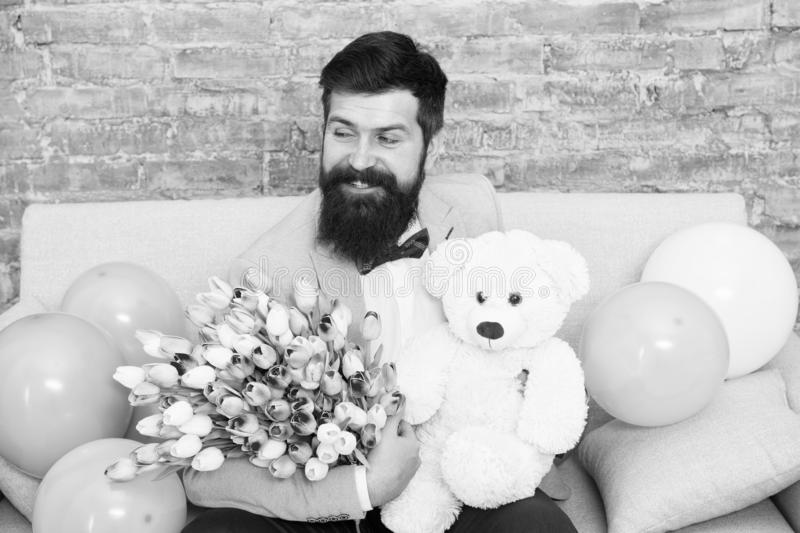 More than words. Womens day. Flower bouquet for March 8. Love bouquet. international holiday. happy bearded man with stock photos