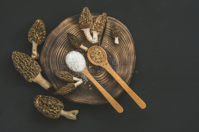 Morel mushrooms - Morchella, sea salt and spices on the wooden s. Poon stock photos