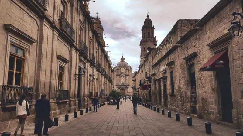 Morelia alley leading to cathedral. An alley in the city of morelia leading to the beautiful cathedral stock images