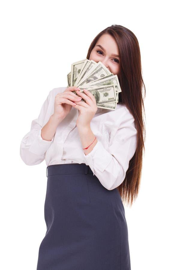 Morena bonita com dólares em um fundo branco Mulher de negócio nova que mostra o dinheiro na came imagens de stock royalty free