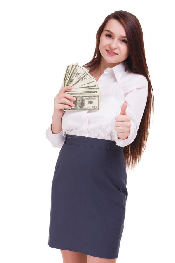 Morena bonita com dólares em um fundo branco Mulher de negócio nova que mostra o dinheiro na came imagem de stock