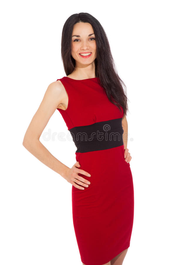 Morena feliz de sorriso bonita no vestido vermelho fotos de stock