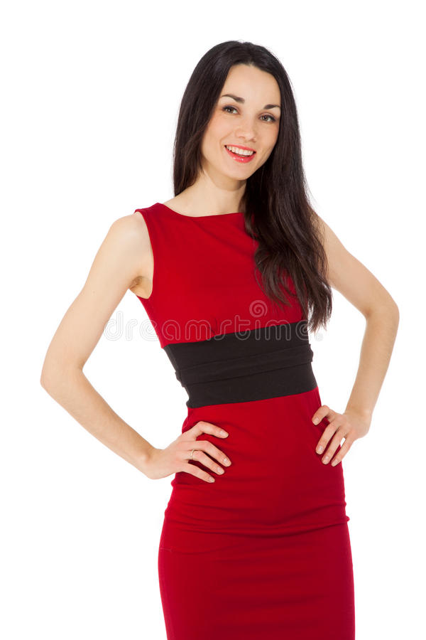 Morena feliz de sorriso bonita no vestido vermelho imagem de stock royalty free