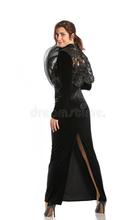 Morena no vestido preto longo fotografia de stock