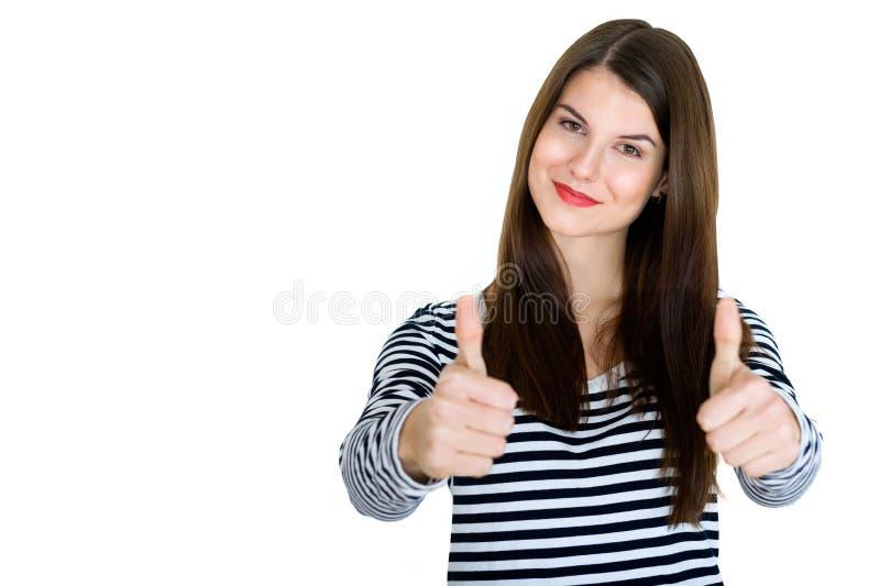 Morena nova lindo que mostra os polegares grandes acima imagem de stock royalty free