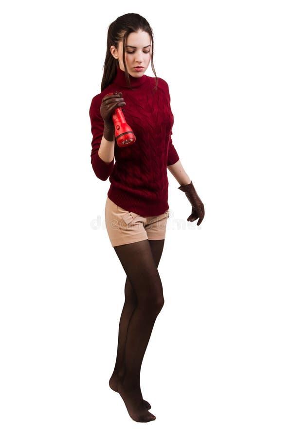 Morenita en rojo con una linterna fotografía de archivo libre de regalías