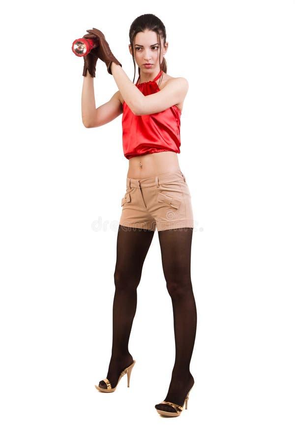 Morenita en rojo con una linterna foto de archivo libre de regalías