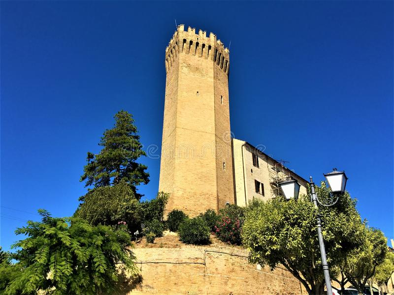 Moresco town in Fermo province, Marche region, Italy. Medieval tower, fortification and trees. Moresco town in Fermo province, Marche region, Italy. Medieval royalty free stock images