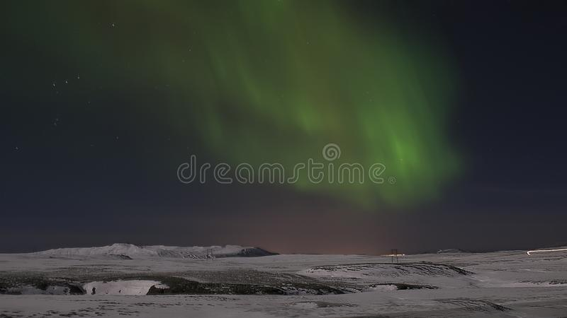 Morgonrodnad i natthimmel iceland snow natt arkivbilder