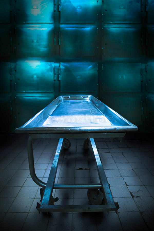 Morgue tray on a grungy morgue royalty free stock images
