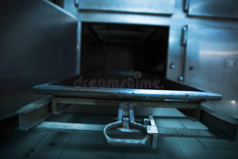 Morgue tray on a grungy morgue stock photography