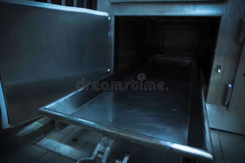 Morgue tray on a grungy morgue stock photos