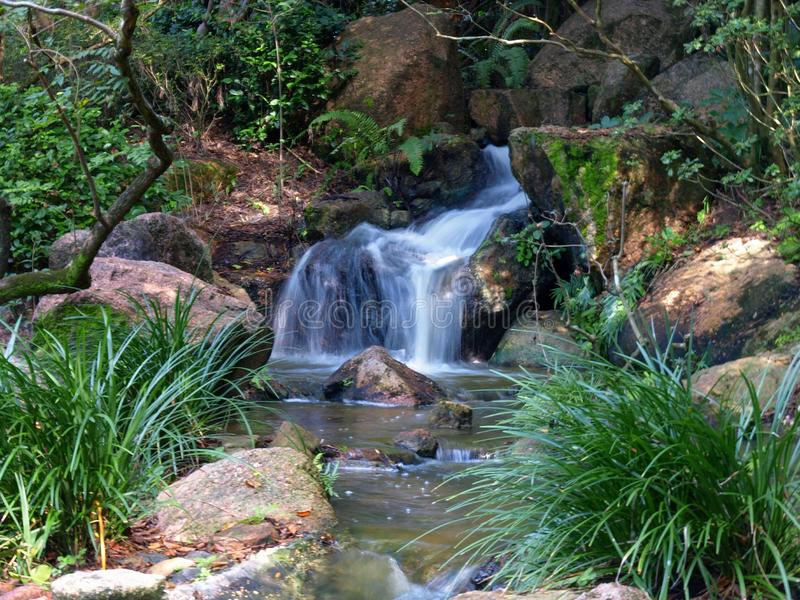 Morikami Waterfall. Waterfall at the Morikami Museum and Gardens in West Palm Beach, Florida royalty free stock photography