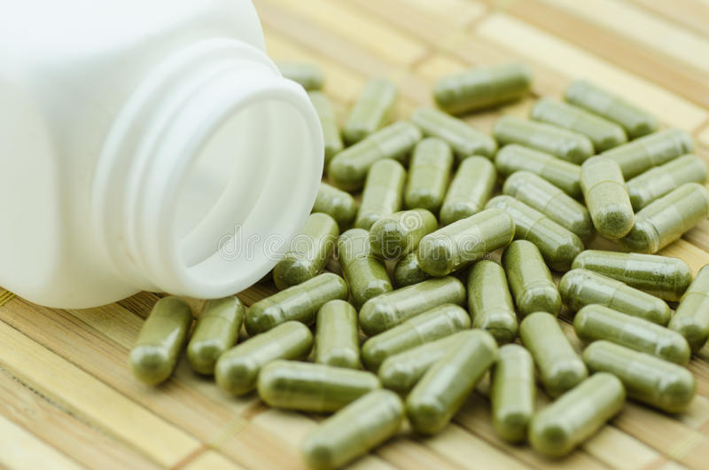 Moringa capsule pills with medicine bottles stock photos