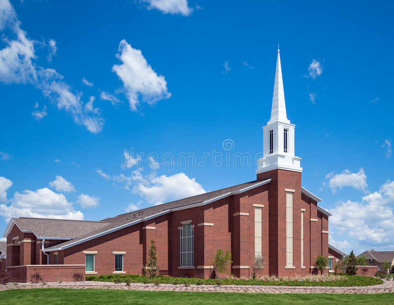 Mormon church. Against blue sky and white clouds stock photos