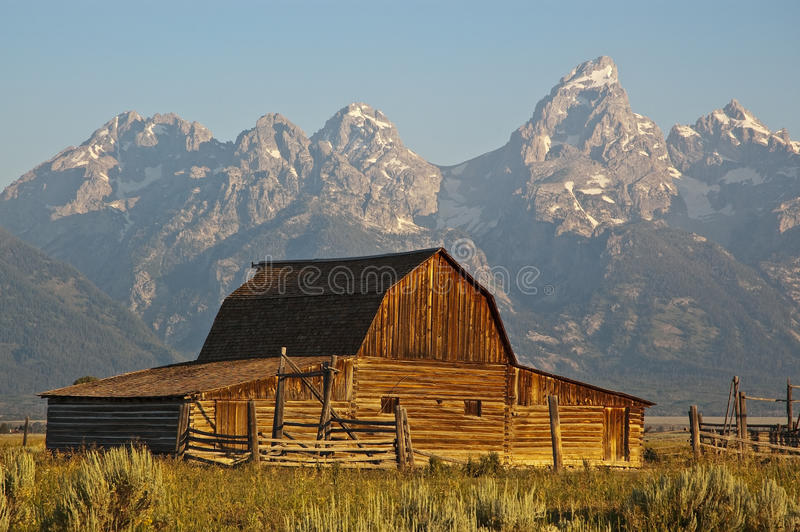 Mormon Row Barn. A Mormon Row barn sits below the towering Tetons in Grand Teton National Park, Wyoming royalty free stock photo