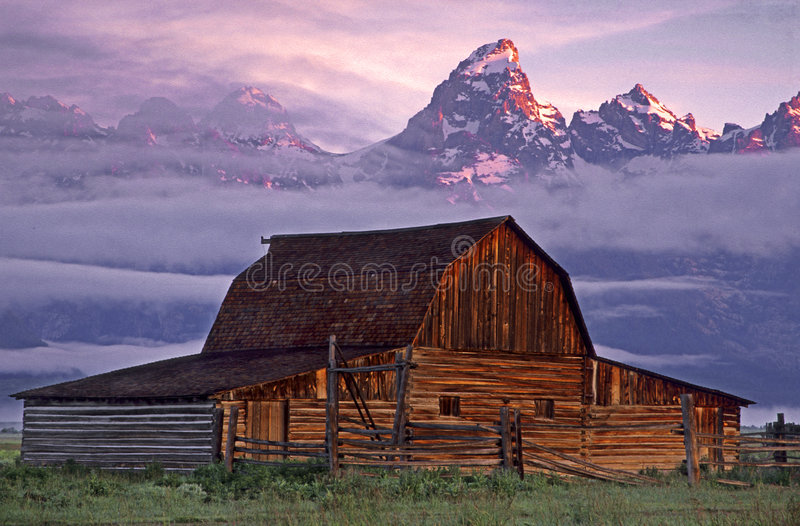 Mormon Row Barn. At sunrise, Grand Teton National Park stock photo