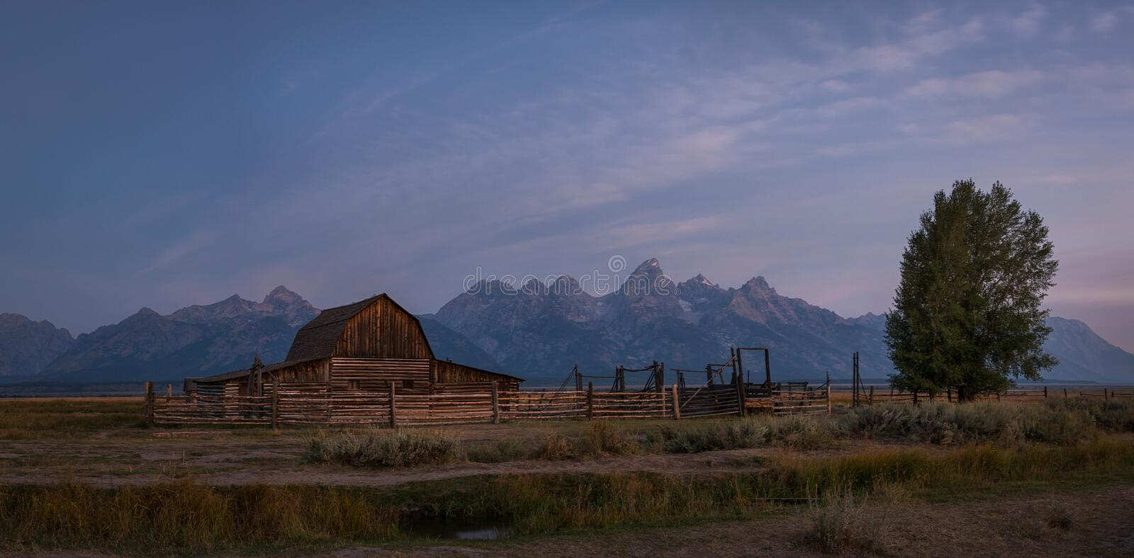 Mormon Row Sunrise Panorama. Early sunrise panorama at Mormon Row in Wyoming stock photography