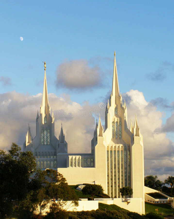Mormon Temple. White Mormon Temple on blue sky at sunset stock photo