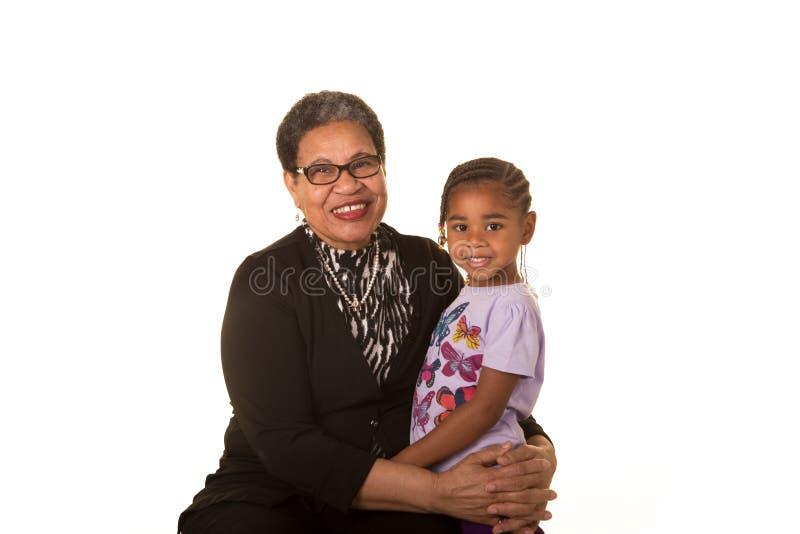 Mormor och barnbarn arkivfoto