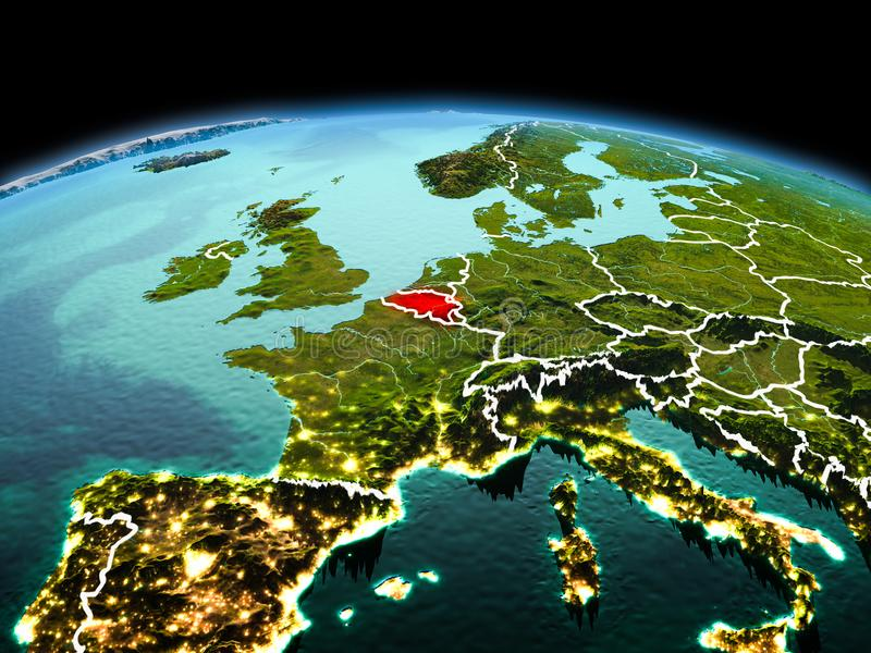 Belgium on planet Earth in space. Morning above Belgium highlighted in red on model of planet Earth in space with visible border lines and city lights. 3D royalty free stock images