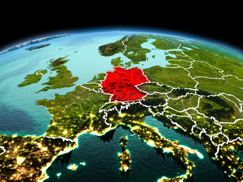 Germany on planet Earth in space. Morning above Germany highlighted in red on model of planet Earth in space with visible border lines and city lights. 3D stock photo