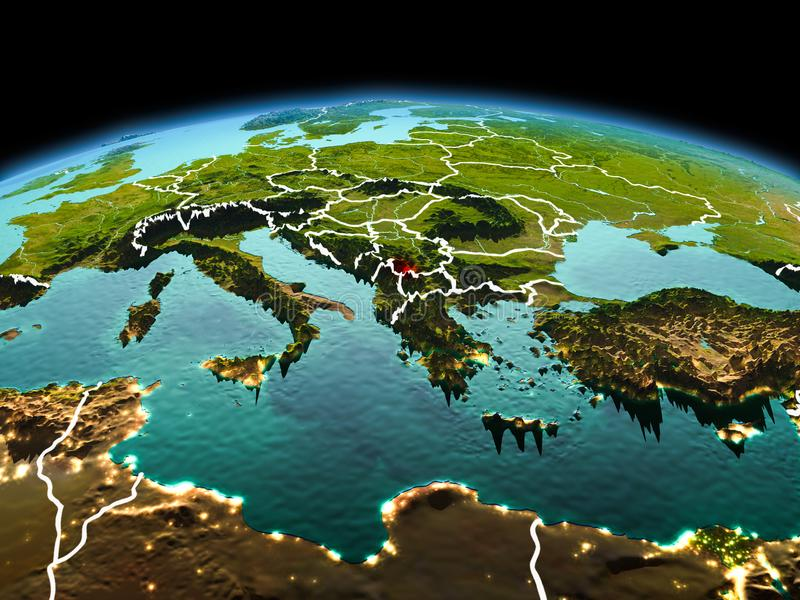 Kosovo on planet Earth in space. Morning above Kosovo highlighted in red on model of planet Earth in space with visible border lines and city lights. 3D stock photos