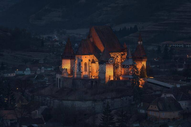 Morning In Biertan, Old Transylvania,One Of Most Famous Four Ancient Fortification Churches Of Romania.Blue Hour.Pastel-Coloured H stock photos