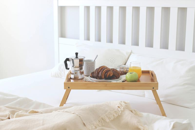 Morning Breakfast in bed. Coffee croissants fresh orange juice stock images