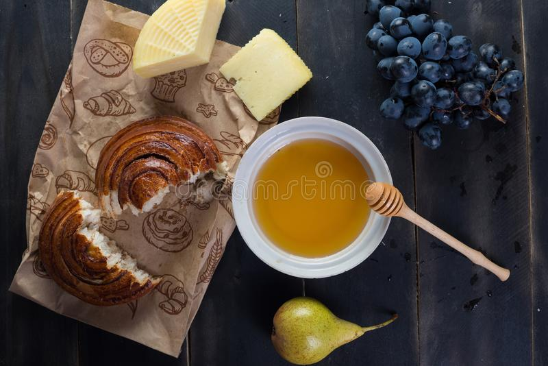 Morning breakfast. Bun, cheese, swet honey and fruits. Homemade food. Morning breakfast. Bun, cheese, swet honey and fruits. Homemade traditional food stock image
