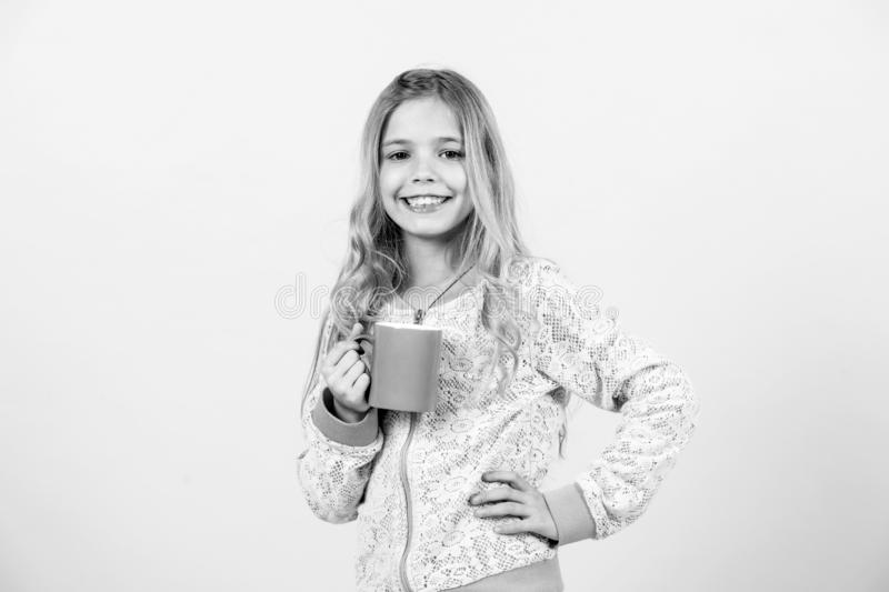 Morning, breakfast concept. black and white. little girl. Morning, breakfast concept. Happy child smiling with mug in hand. Girl smile with blue cup on orange stock photo