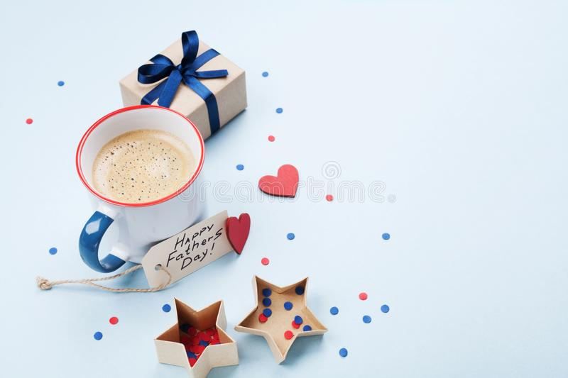 Morning breakfast on Fathers Day with coffee cup, gift or present box and heart. royalty free stock photos