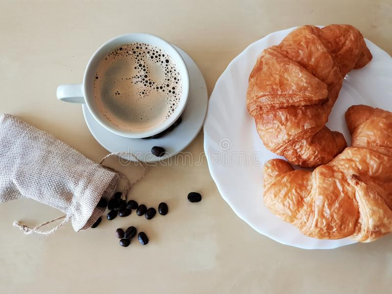 Morning Breakfast with Hot Americano Coffee and Croissant stock images
