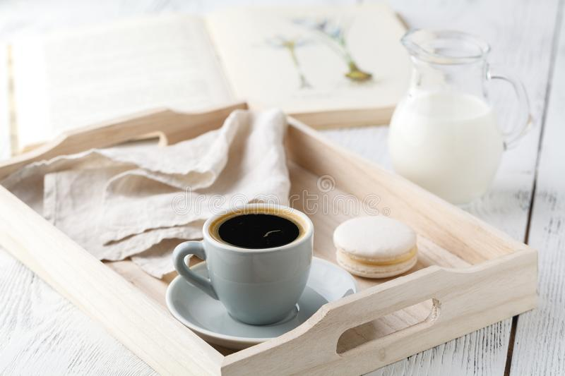 Morning breakfast, mug with coffee, book on a wooden tray royalty free stock photos