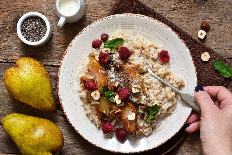 Morning breakfast. Oatmeal, caramelized pear royalty free stock images