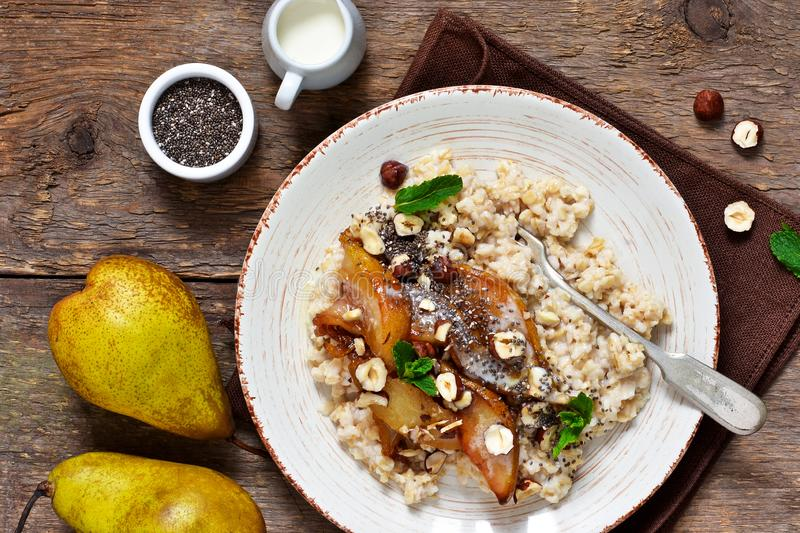Morning breakfast. Oatmeal, caramelized pear stock photography