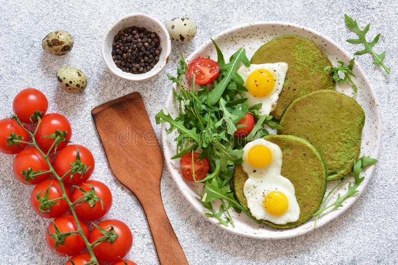 Morning breakfast: pancakes with spinach, salad and egg royalty free stock photography
