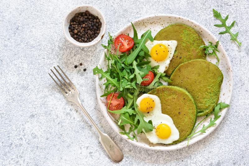 Morning breakfast: pancakes with spinach, salad and egg o royalty free stock images