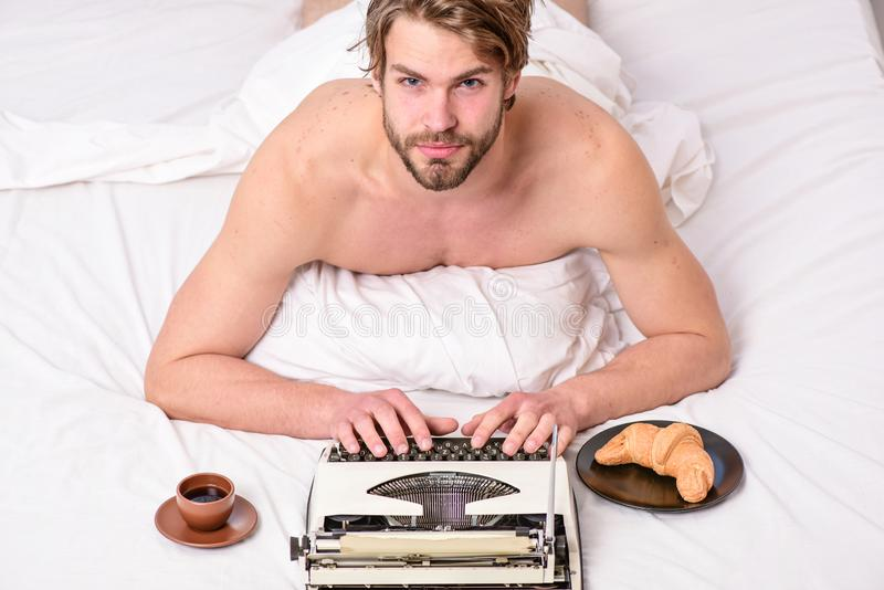 Morning bring fresh idea. Morning inspiration. Erotic literature. Daily routine of writer. Writer handsome author used. Old fashioned manual typewriter. Man stock photography