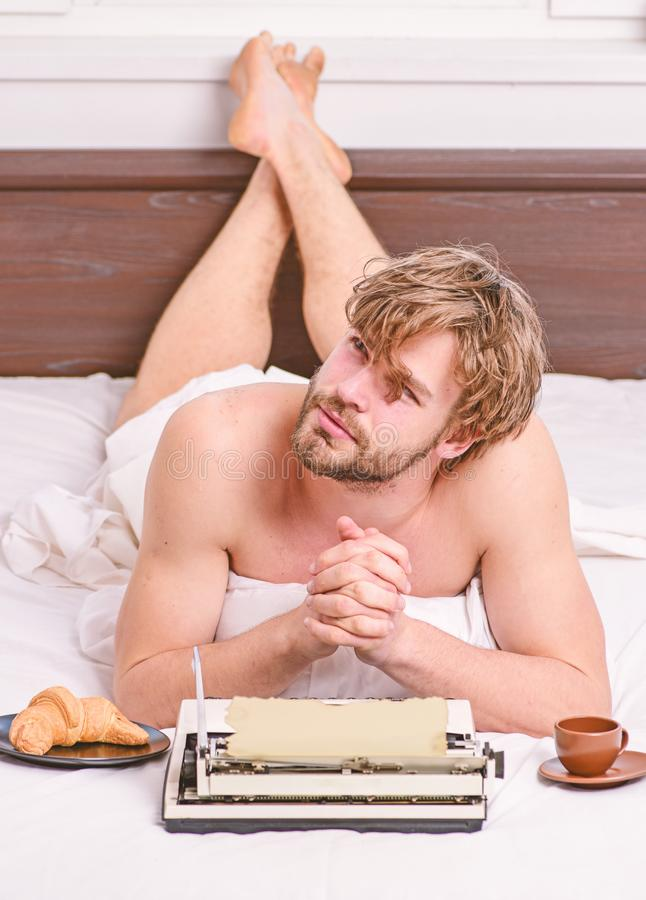Morning bring fresh idea. Need inspiration. Crisis creativity. Daily routine of writer. Man writer lay bed with. Breakfast working. Writer handsome author used stock photo