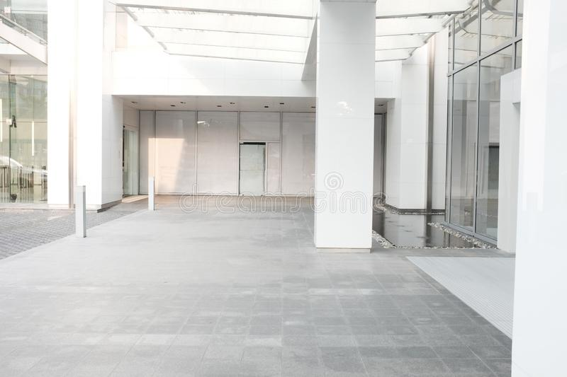 Morning Business building background office lobby hall interior. Empty indoor room with blurry light from glass wall window stock images