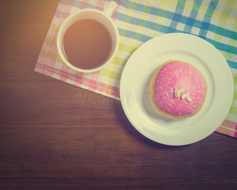 Morning Cafe table with hot coffeee and donut. With copy space below stock photos