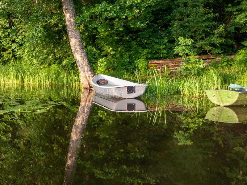 The boat docked in the lake, royalty free stock photos